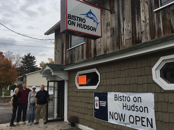 Exterior of Bistro on Hudson restaurant with owner and family