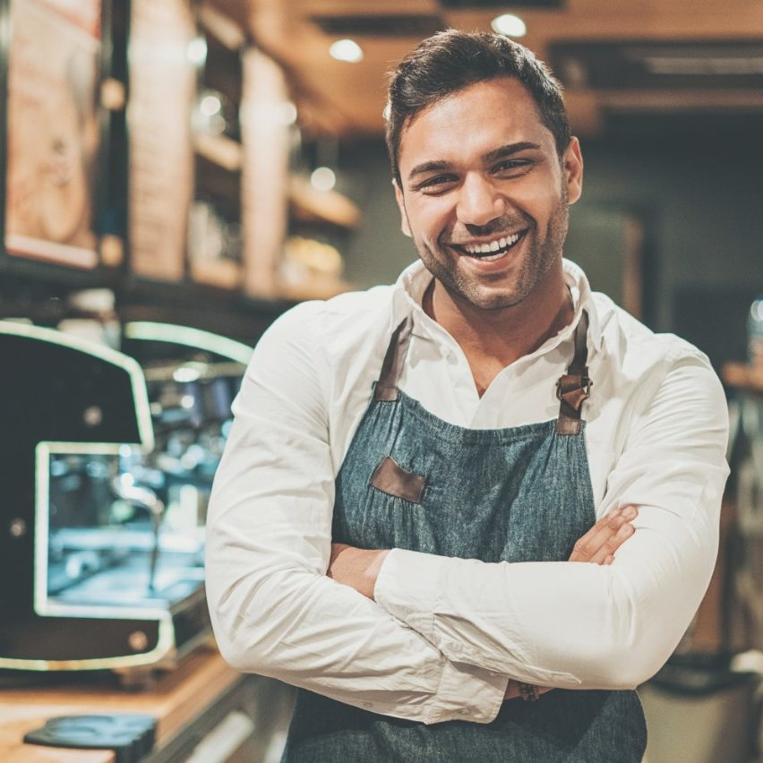 Smiling barista in a coffee shop
