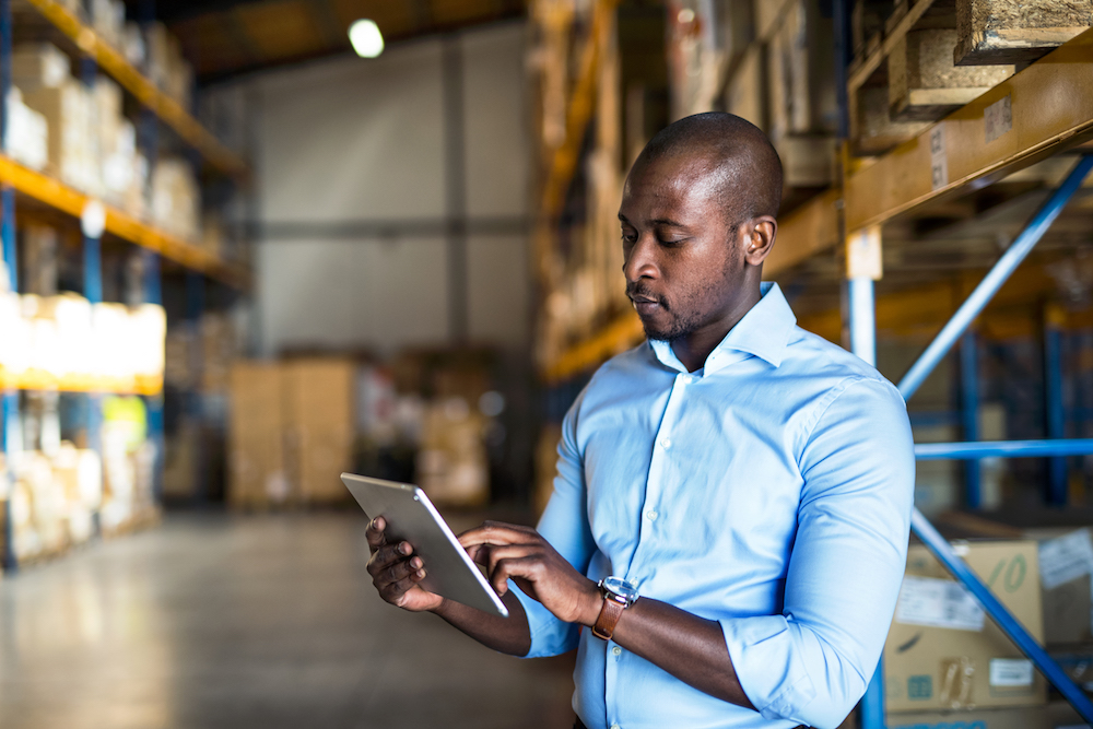 An african-american supervisor using tablet. Copy space.