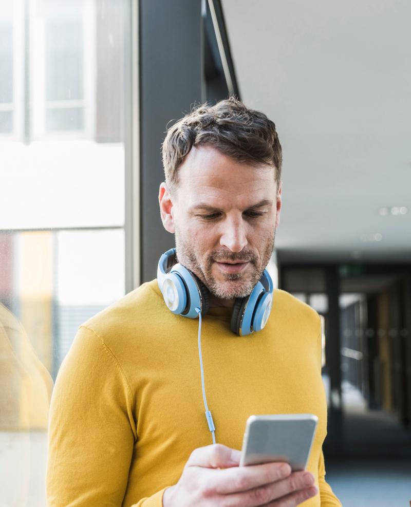 Man checks payments through mobile