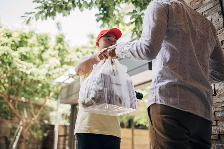Delivery man bringing food to a customer