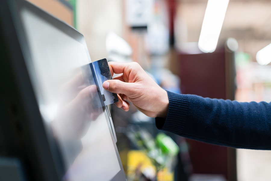 asian man checkout with Self service  in supermarket
