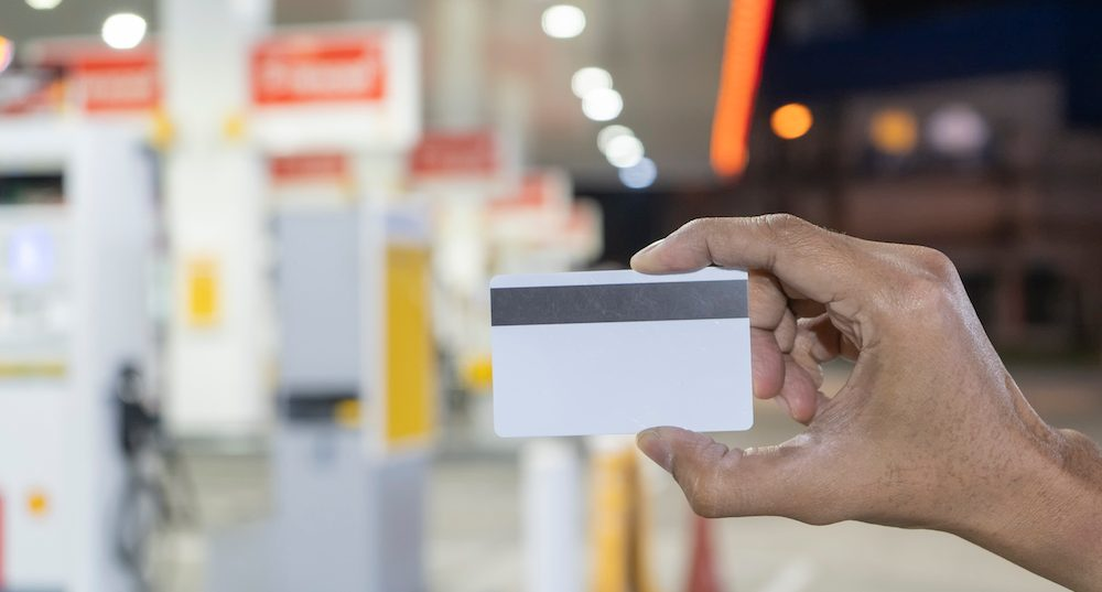 Credit card to make a payment for refueling car on gas station.