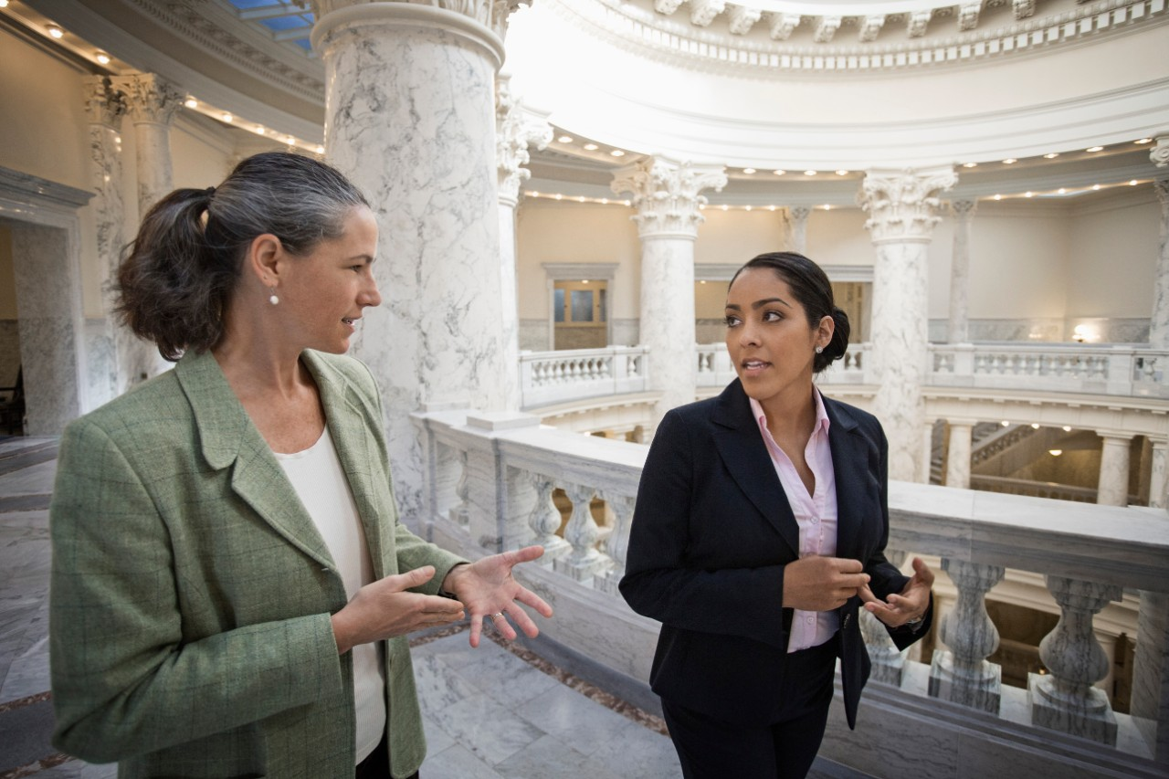 Female Politicians talking in government building