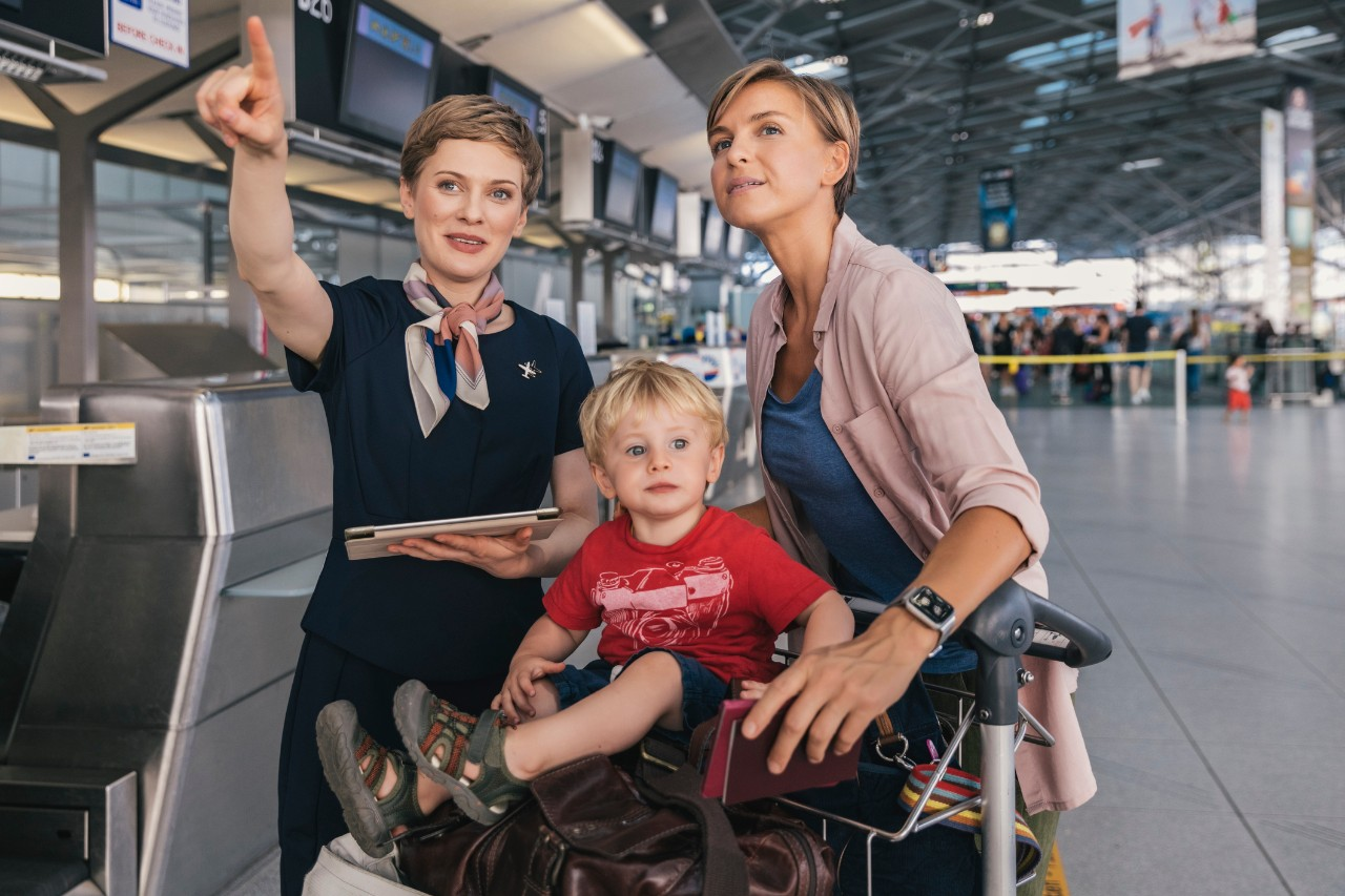 two women and child at airport travel