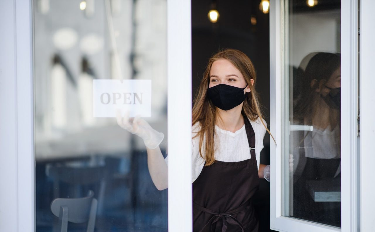 Masked restaurant owner opens to customers