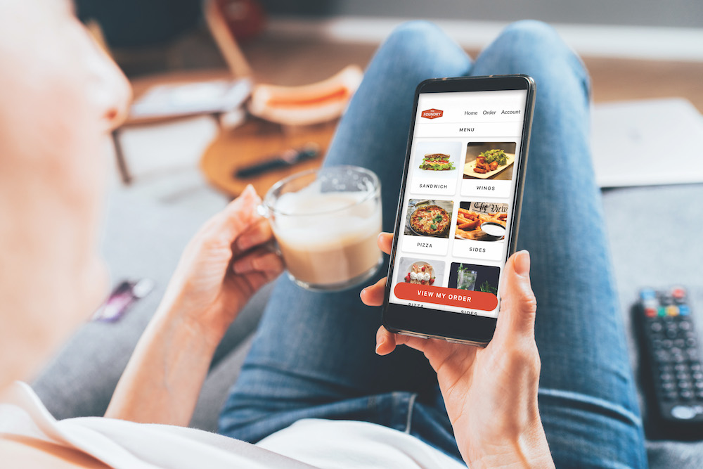 Woman ordering food online on her electronic device