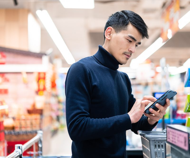 asian man checkout in supermarket