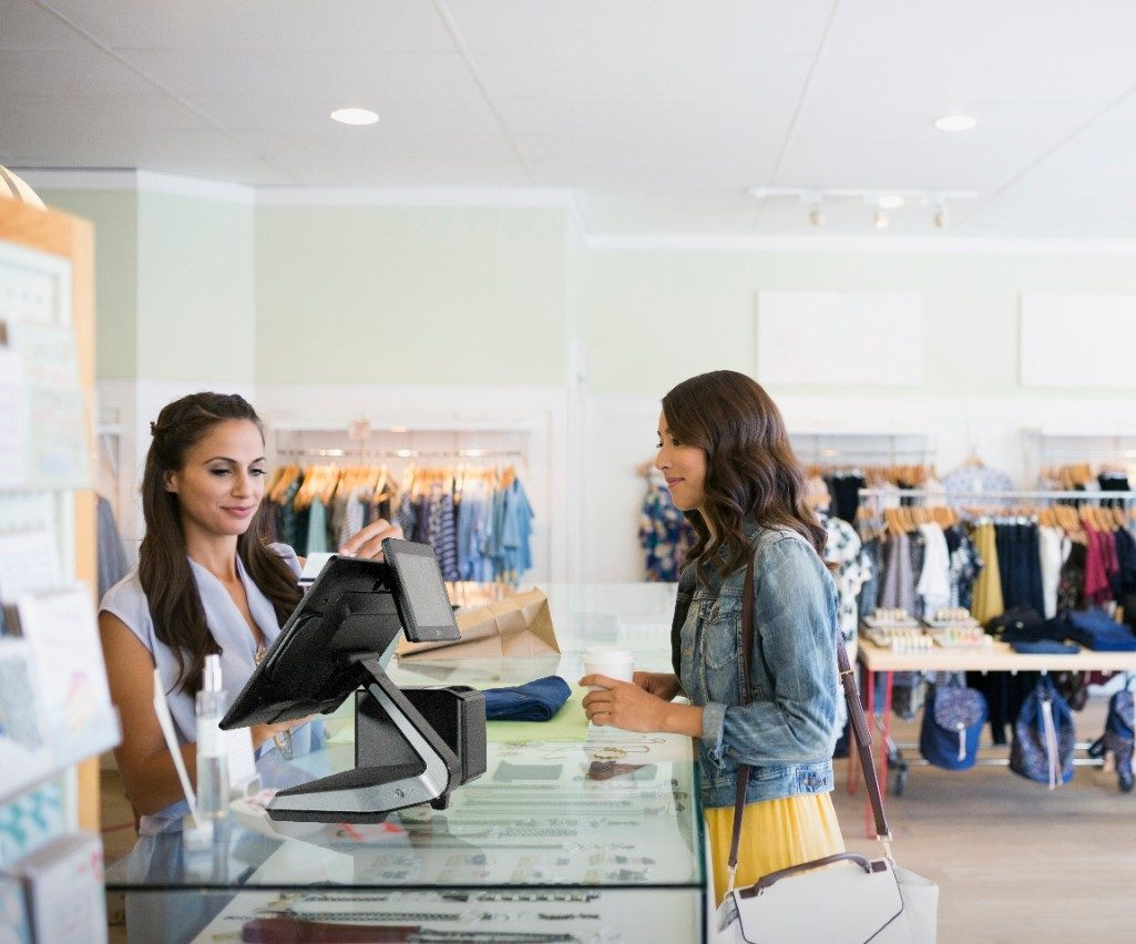 Photo of Woman shopping and paying using NCR POS ARS with CXS-CX7