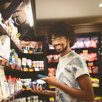 Young man buying food in a supermarket