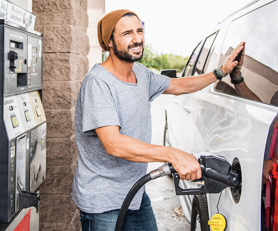 Man fueling his vehicle