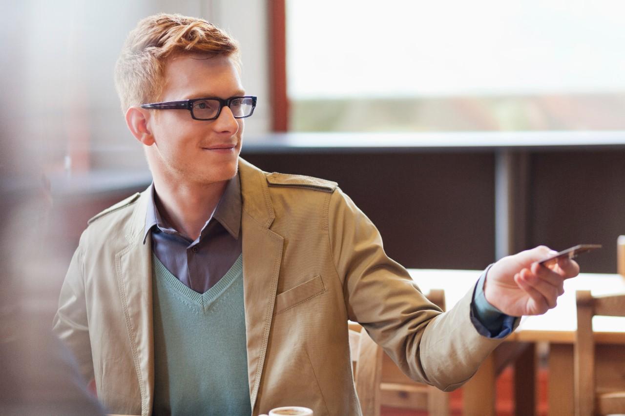 happy customer handing over his credit card