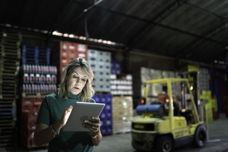 Employee using digital tablet at warehouse