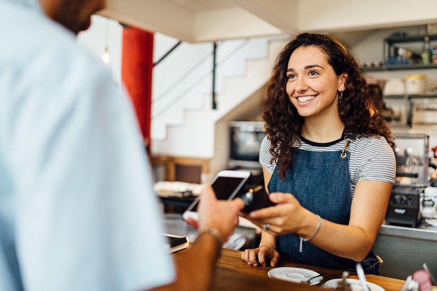 Client pays contactless at coffeeshop