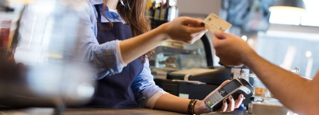Girl at counter taking card payment